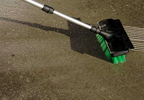 Remove stains on asphalt & concrete